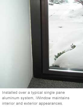 Installed over a typical single pane aluminum system, iWindow maintains interior and exterior appearances.